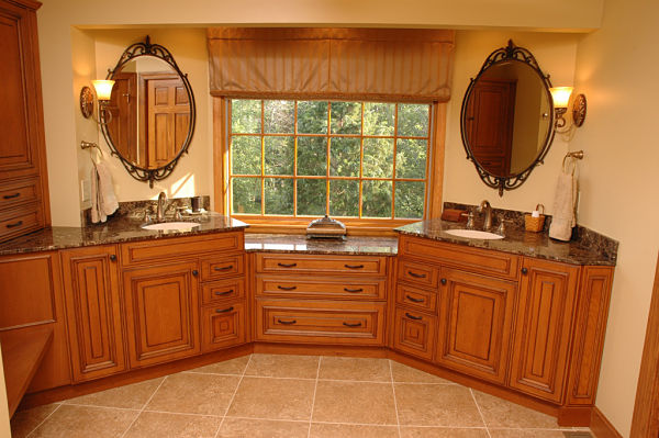 bathroom with cherry cabinets and marble countertops