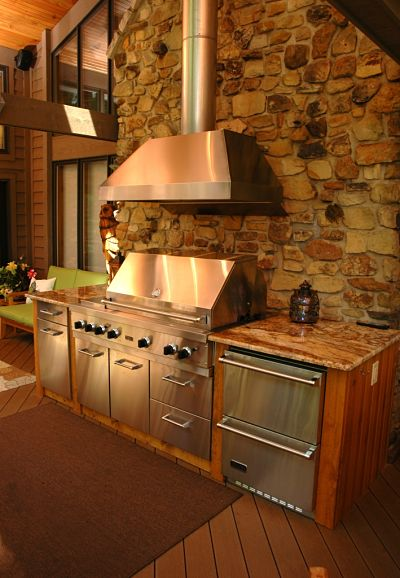 porch with large grill and hood