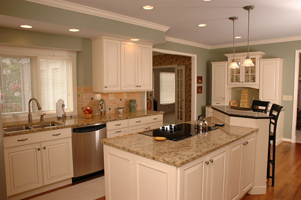 kitchen with white cabinets and tiered island