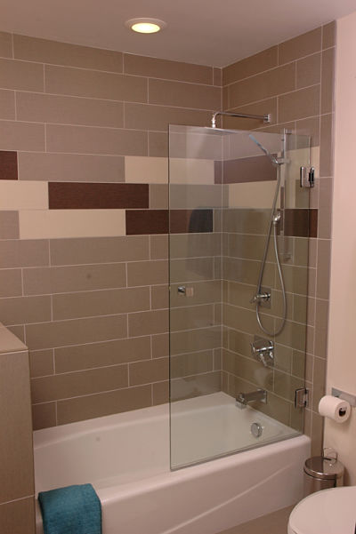 tub and shower with tile surround
