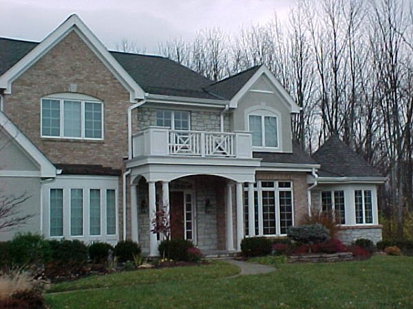 country french home with portico