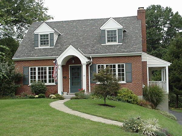 cape cottage with white portico