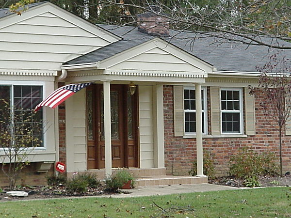 Federalist style home with portico