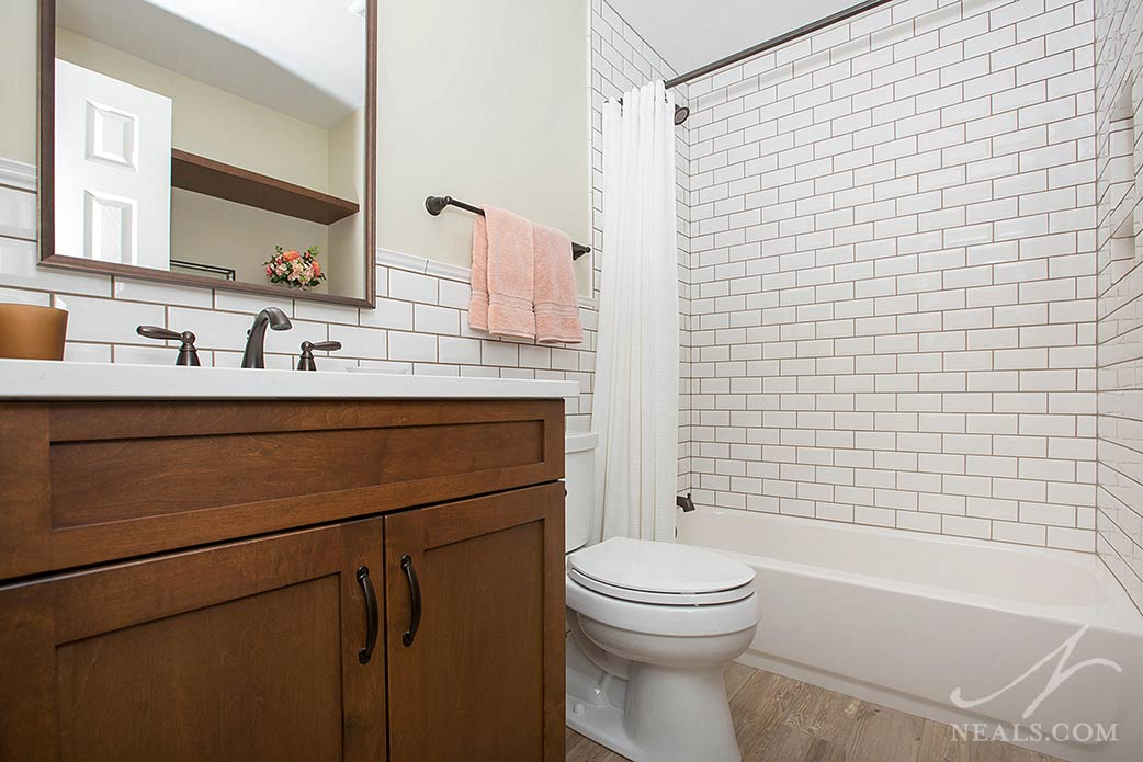 Subway tile features heavily in this hall bathroom in Loveland.