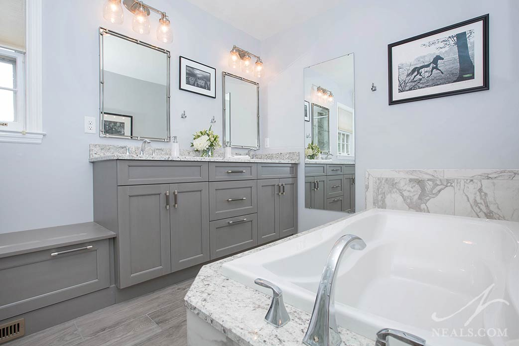The tub in this Anderson Township bathroom is specially contoured for soaking comfort.