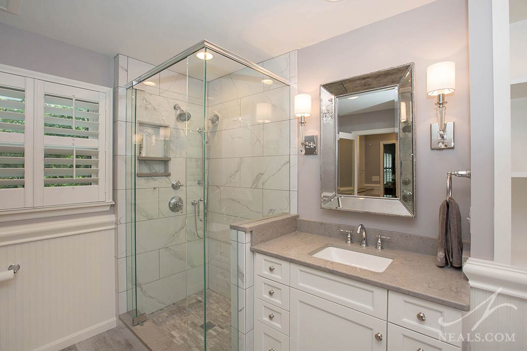 A marble-look porcelain tile was used in the shower for this country chic Indian Hill master bath.
