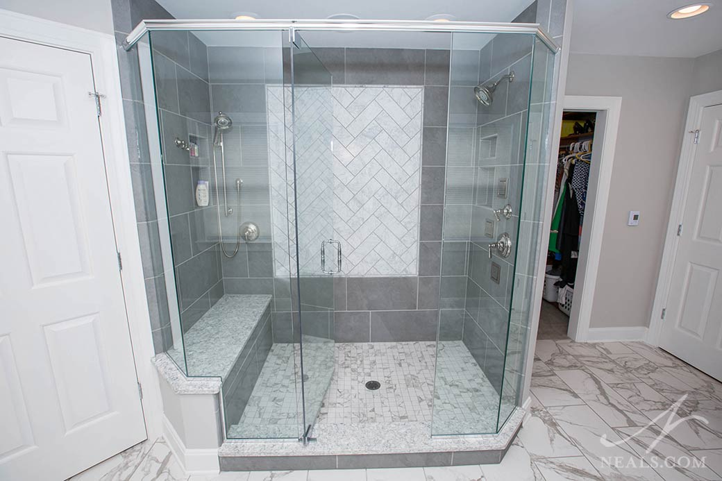 large walk-in shower with bench