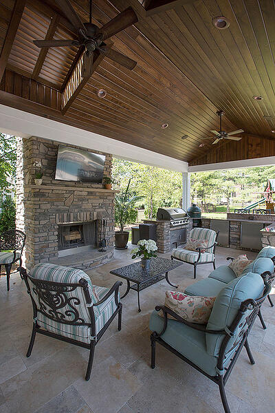 outdoor living area with roof and fireplace