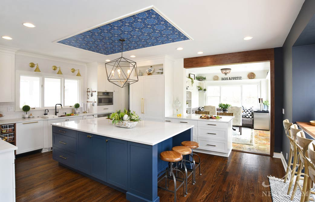 kitchen with a modern chandelier and three wall-mounted lights