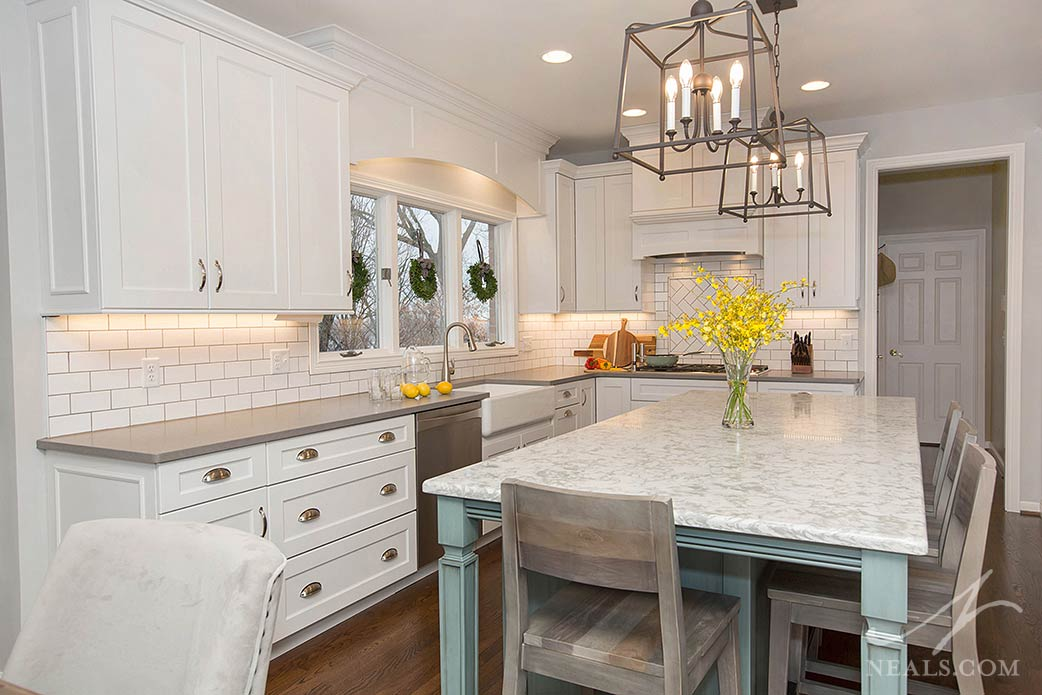 Transitional kitchen with white cabinetry