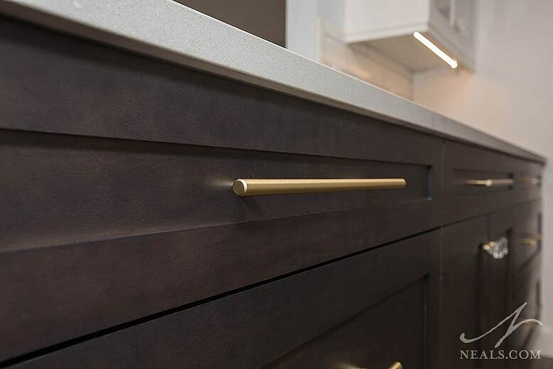 This Colerain kitchen remodel uses gold-finished hardware in a contemporary bar handle style.