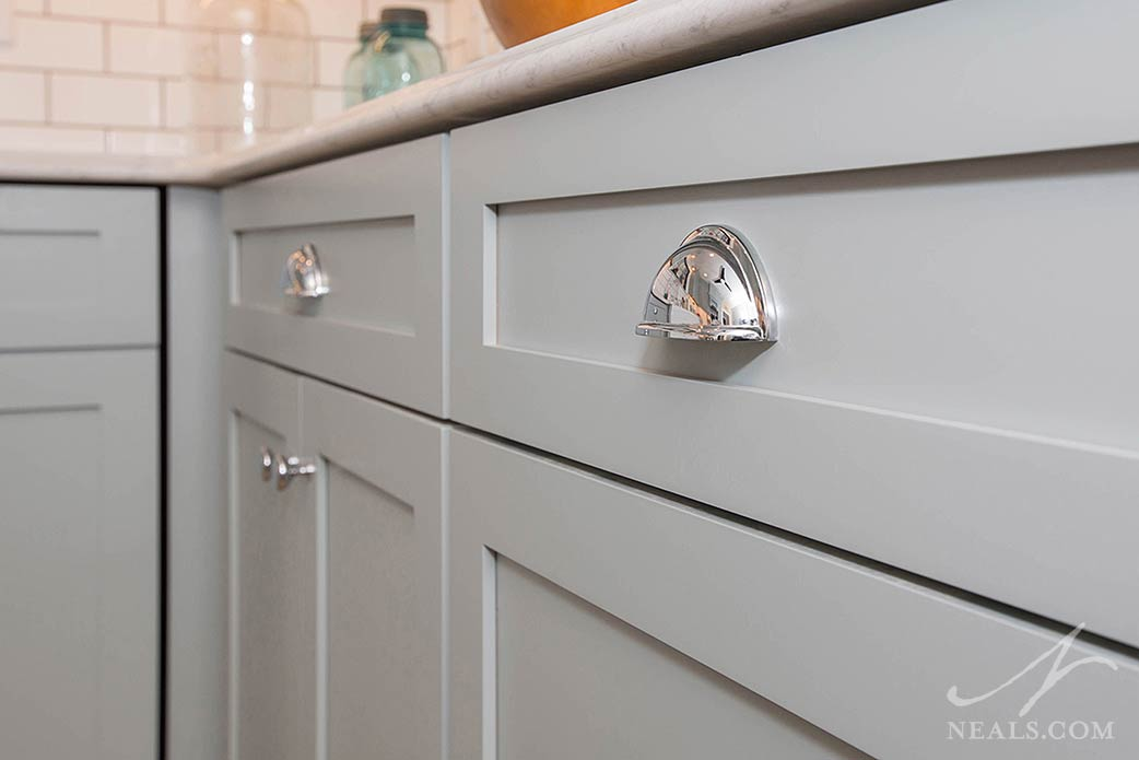 Reflective polished nickel knobs in an Avondale kitchen remodel.