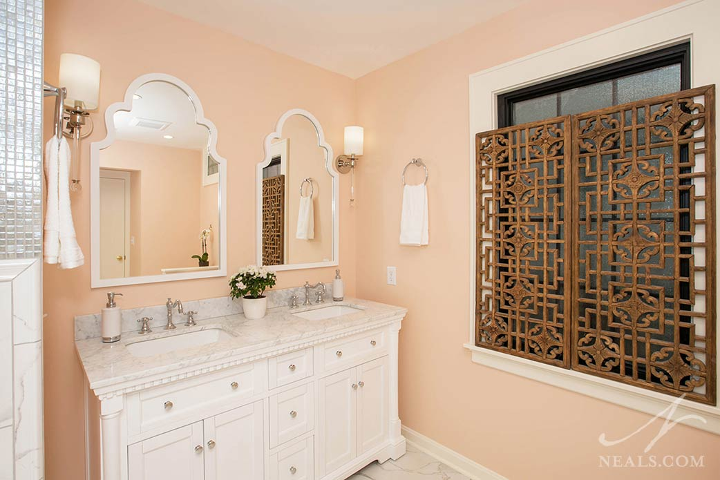 traditional style vanity with shapely mirrors