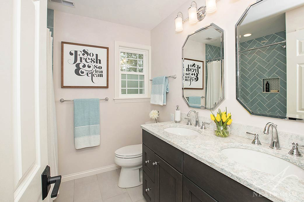 guest bathroom with two sinks