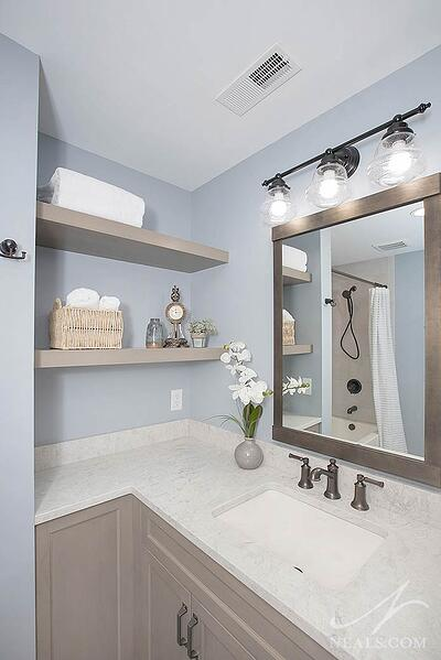 bathroom with open shelving at the vanity