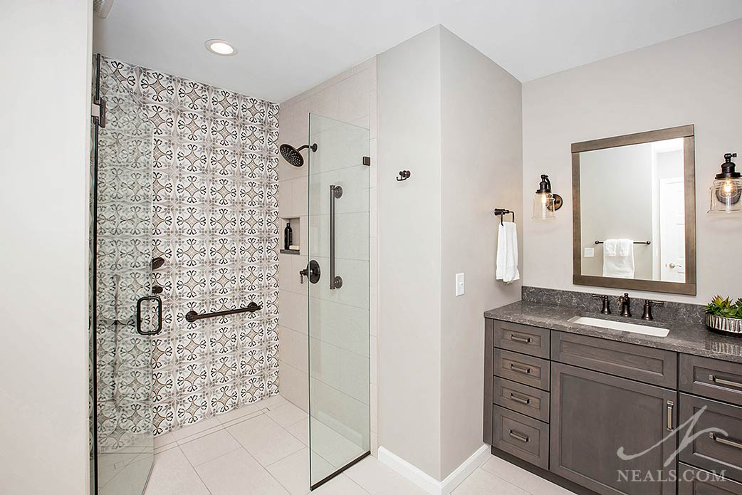 printed tile in the shower in a transitional bathroom
