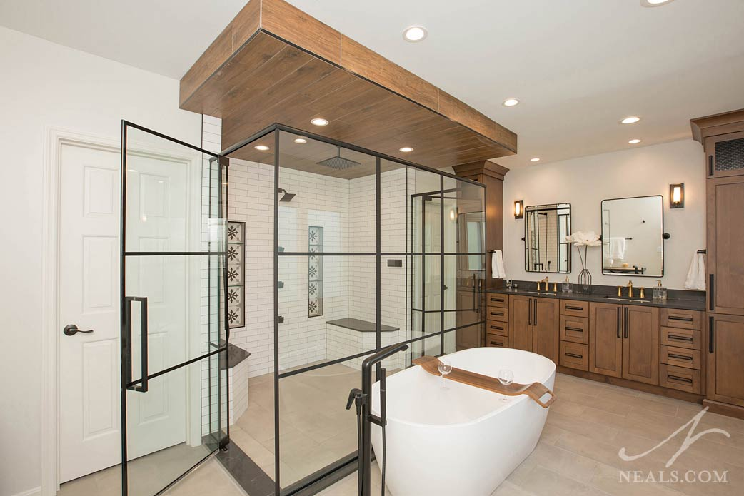 Master bathroom with large central shower enclosure and free standing tub