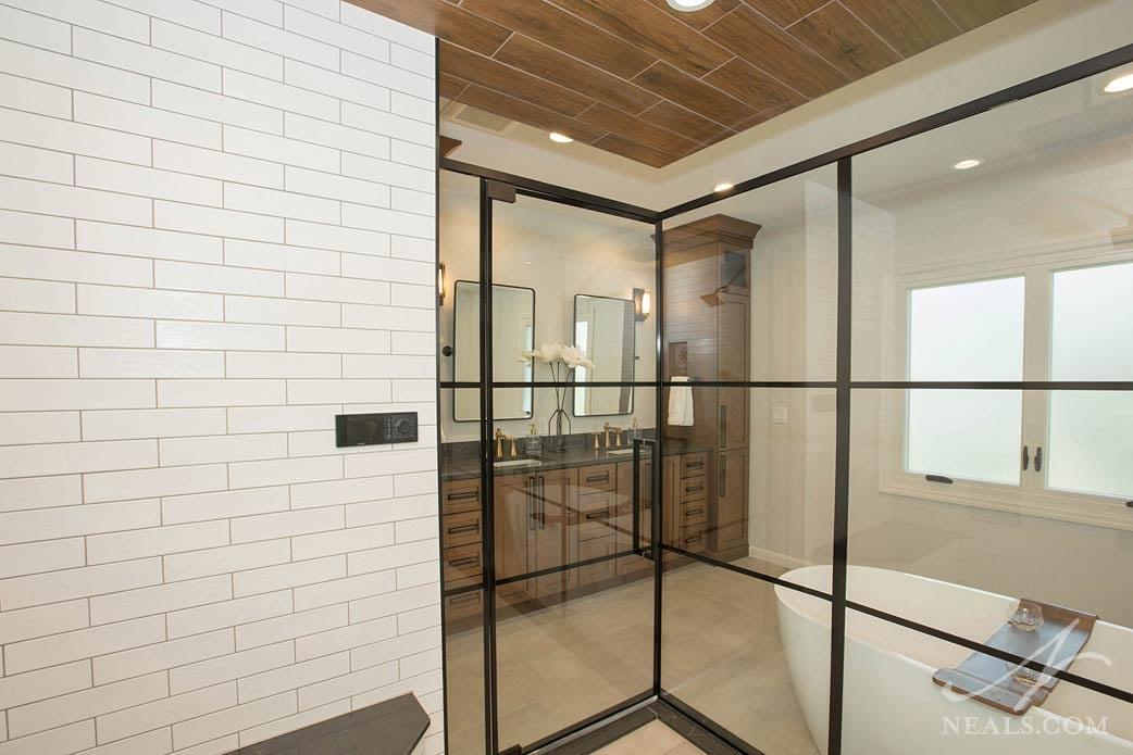 Bathroom double vanity seen from inside shower enclosure