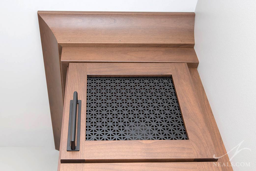 cabinet door insert houses speakers attached to the home's sound system
