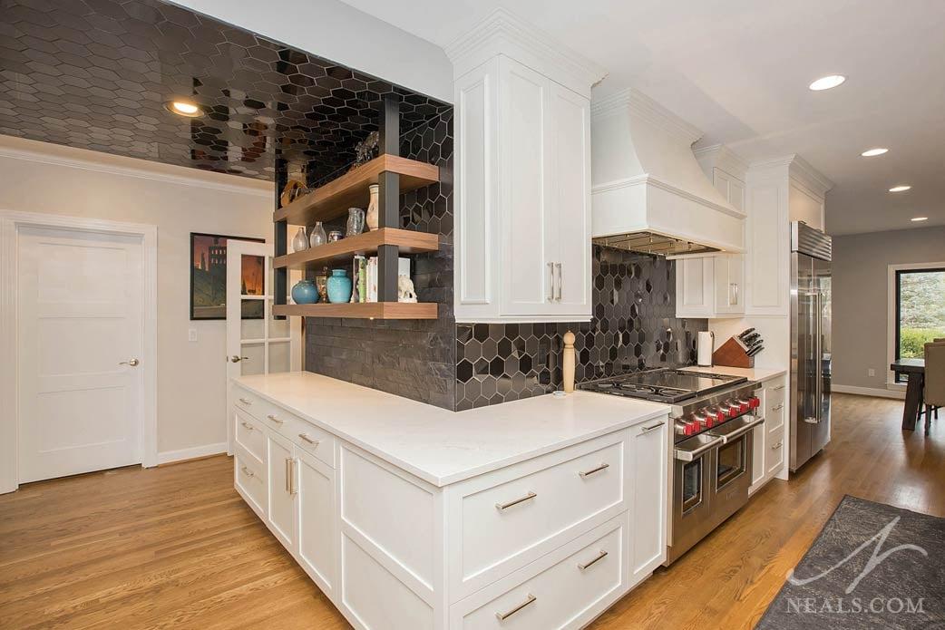 contemporary black backsplash tile in a white transitional kitchen