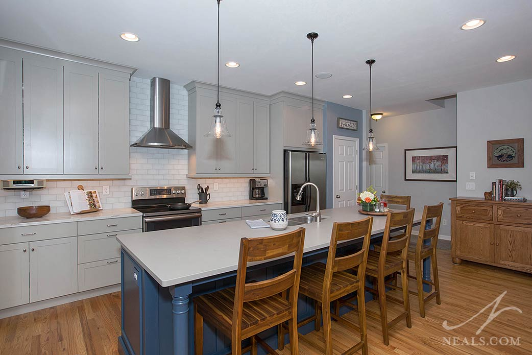 The gray cabinets in this Mason kitchen don't compete with the homeowner taste for warm woods and cool blues.