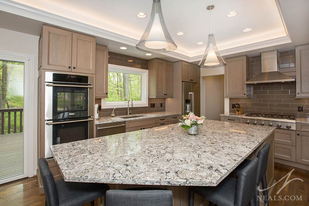 transitional kitchen with warm cabinetry