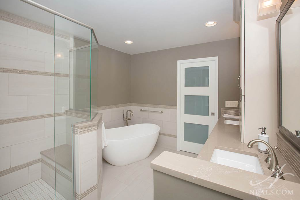 Modern and minimalist free-standing tub in Loveland bathroom remodel.