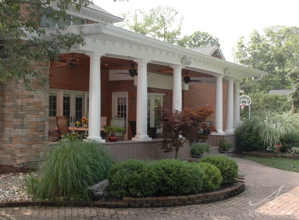With its classic columns, this back veranda adds stately elegance to the home.
