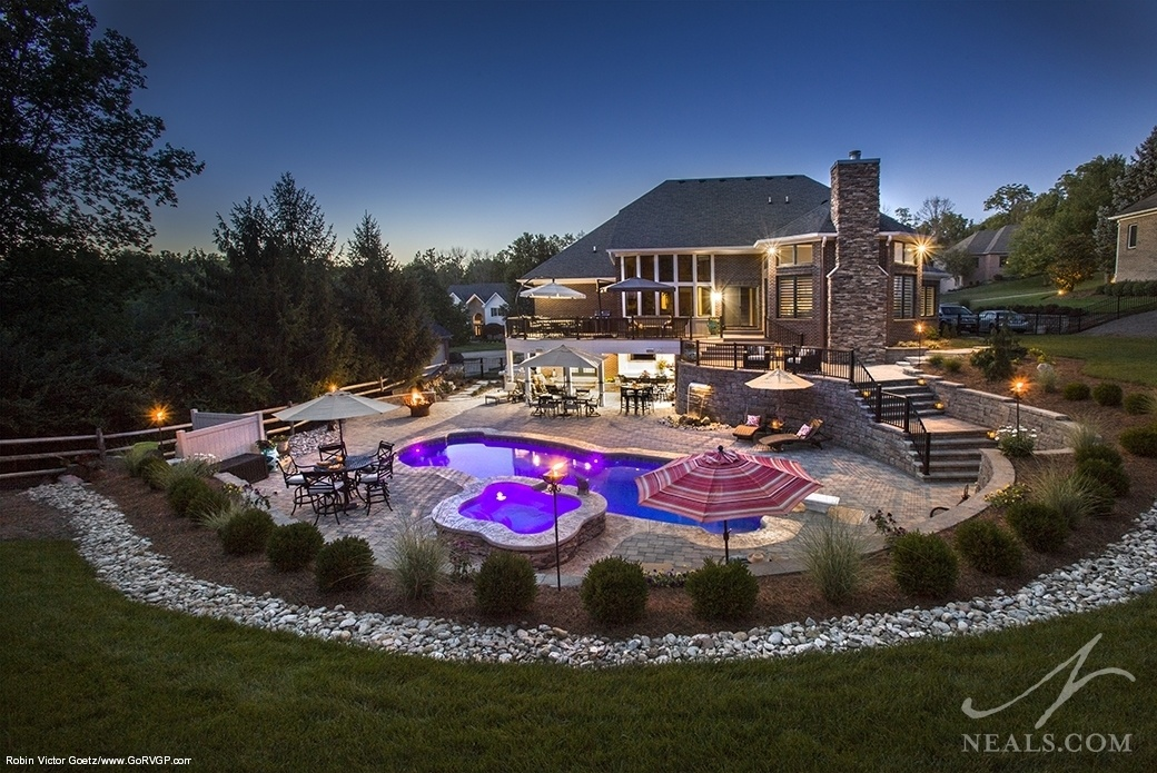 Outdoor living space with several nighttime lighting options.