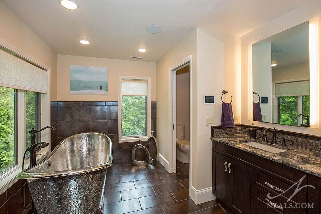 A pocket door makes it easy for the commode to be closed off in this Indian Hill master bathroom.