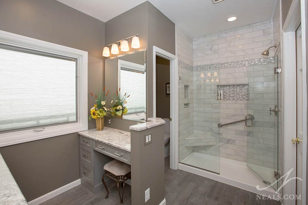 This shower in Pierce Township includes a corner bench and two convenient niches.