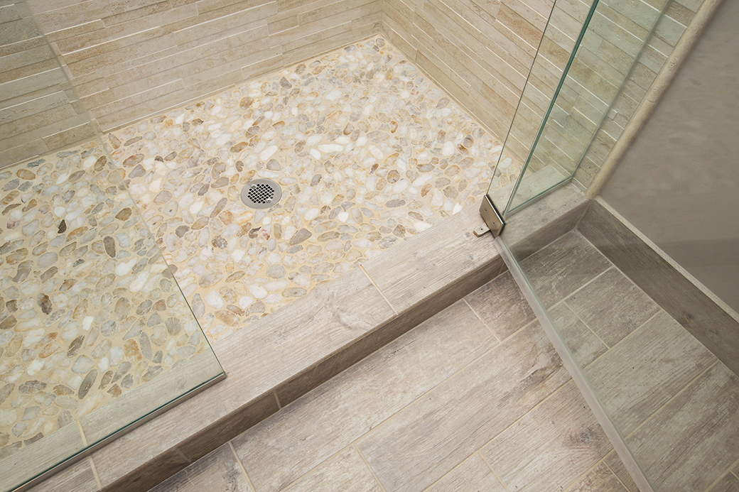 A mixture of coordinating tile options in this Montgomery bathroom.