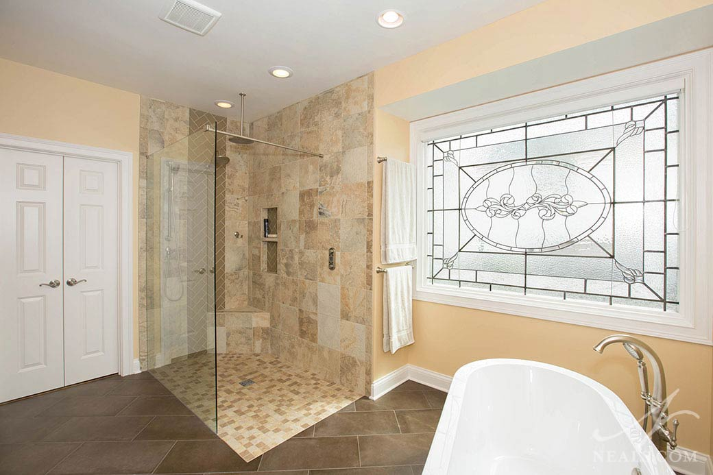 Shower tile extends out beyond the glass wall in this Sycamore Township bathroom.