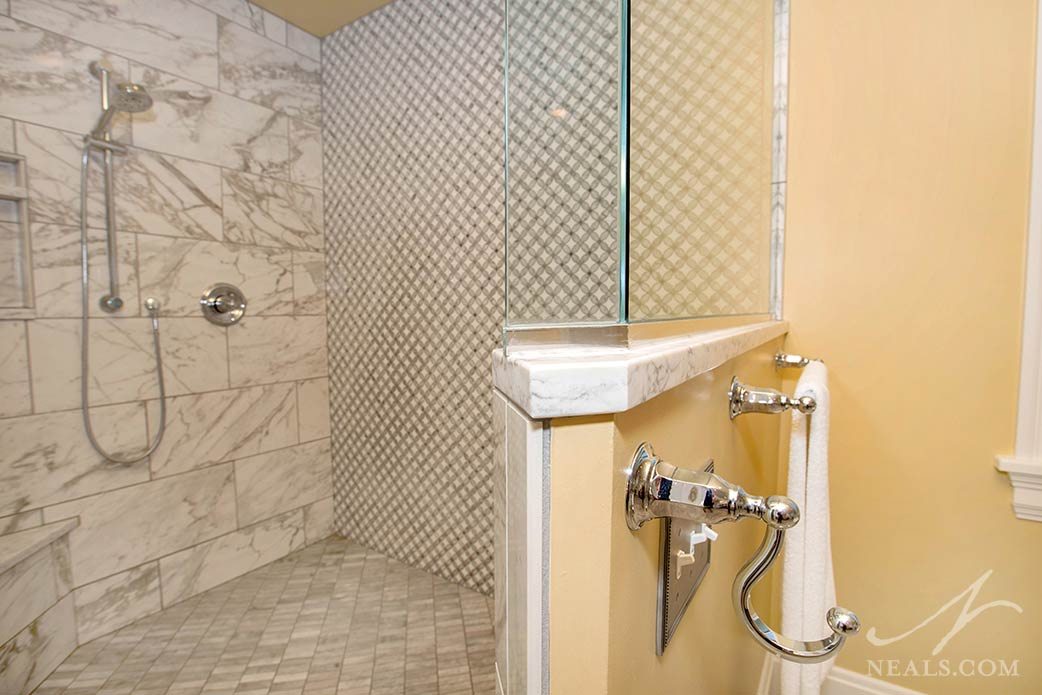 Specialty tile in an interlocked circle design is used as an accent wall in this Hyde Park bathroom.