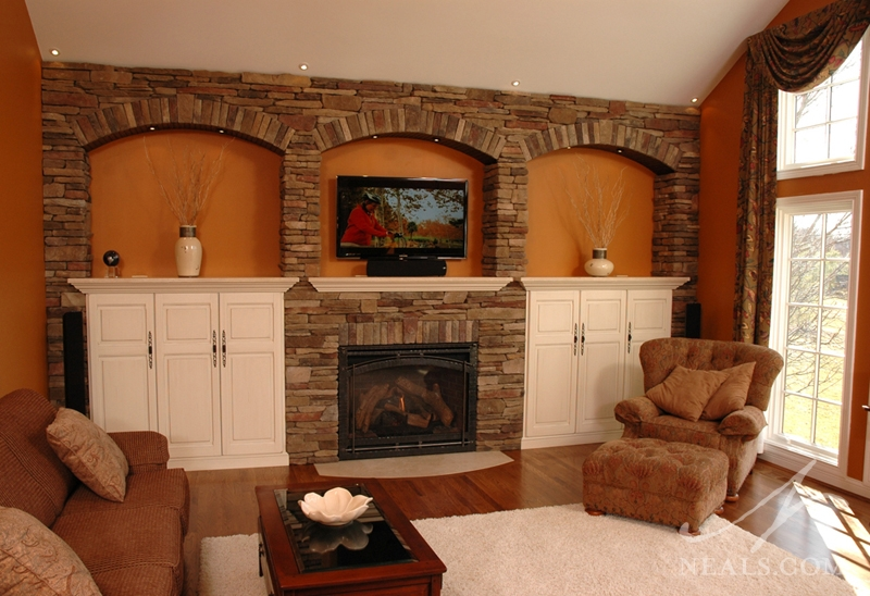 Built-in cabinets surrounding this fireplace in Loveland add ample concealed storage.