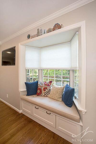 A built-in window seat with a drawer adds interest and storage in this Western Hills kitchen.