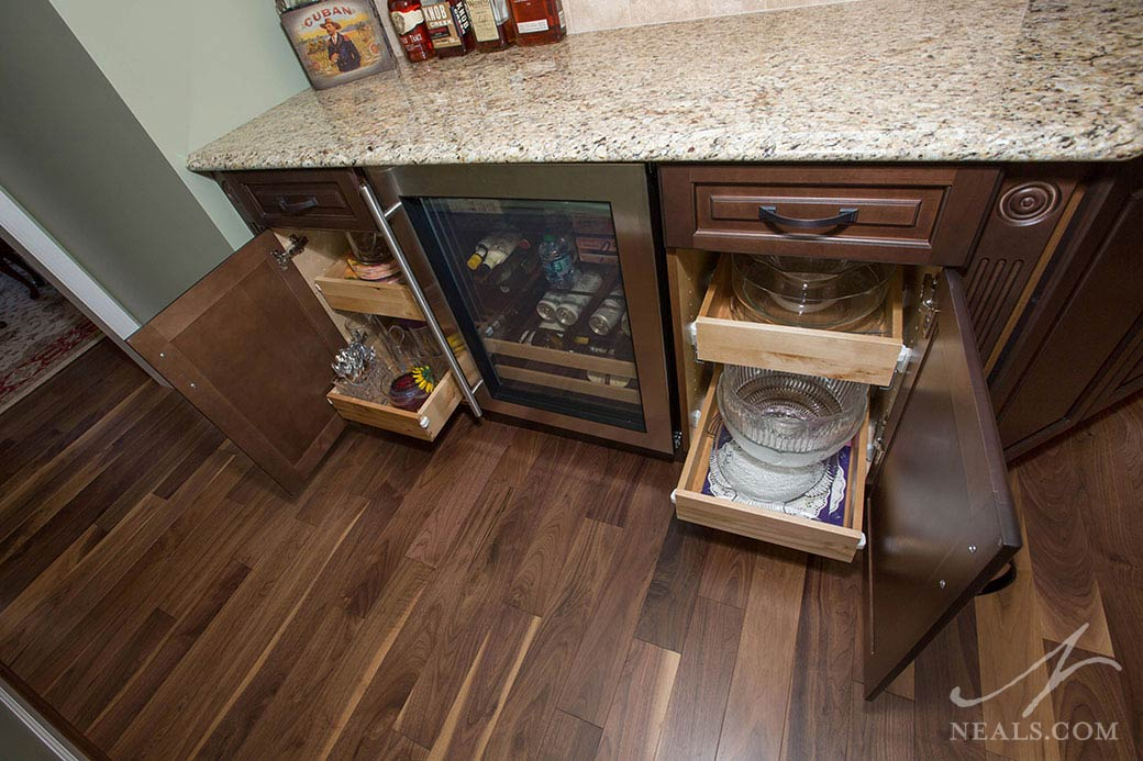 Quality can be observed in kitchen cabinets by looking at the interiors, like the pullout drawer cabinets in this Loveland kitchen.