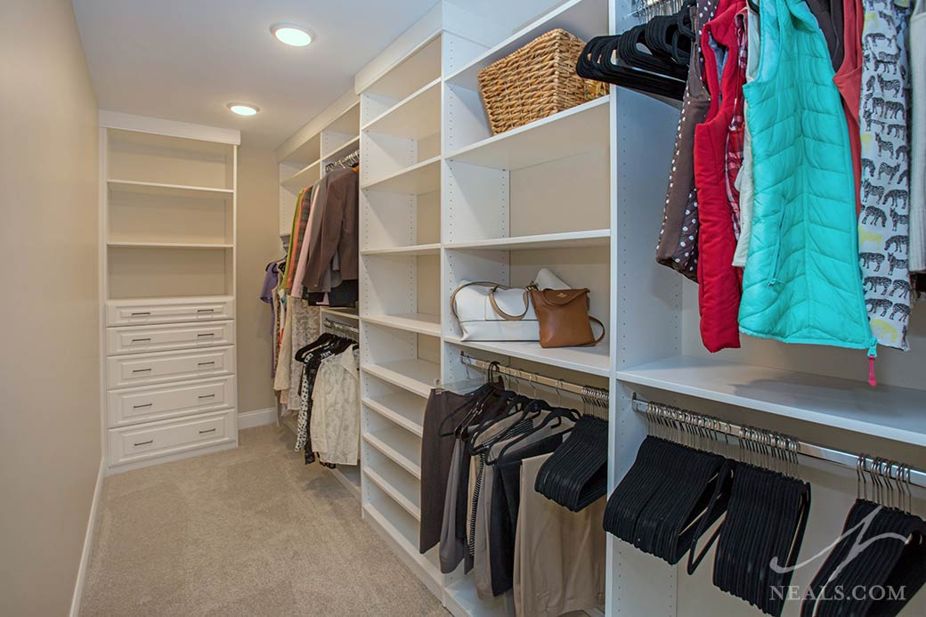 This narrow closet in Maineville provides zones of storage for specific types of items.