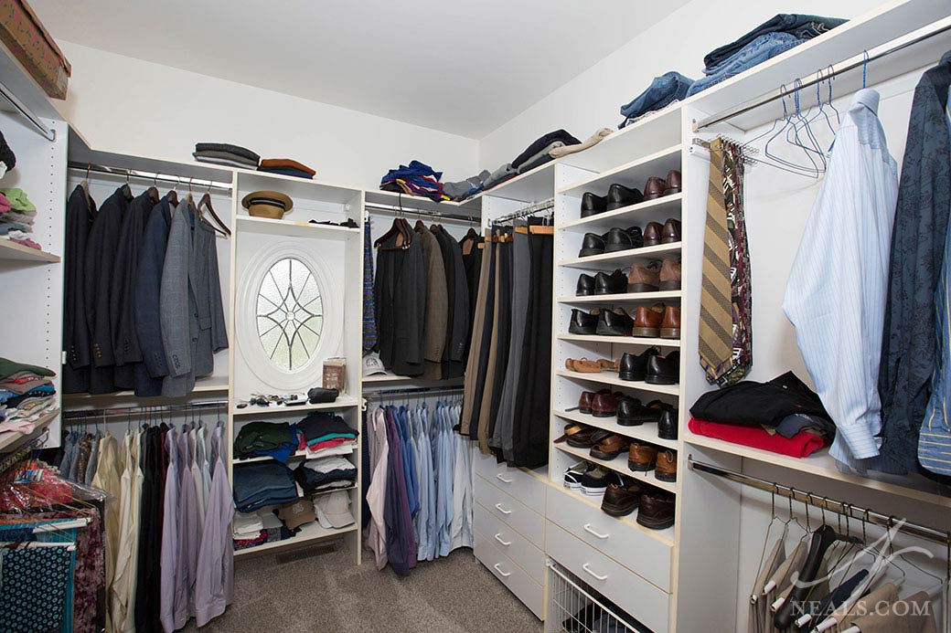 This Sycamore Township walk-in closet features a variety of clothes storage options.