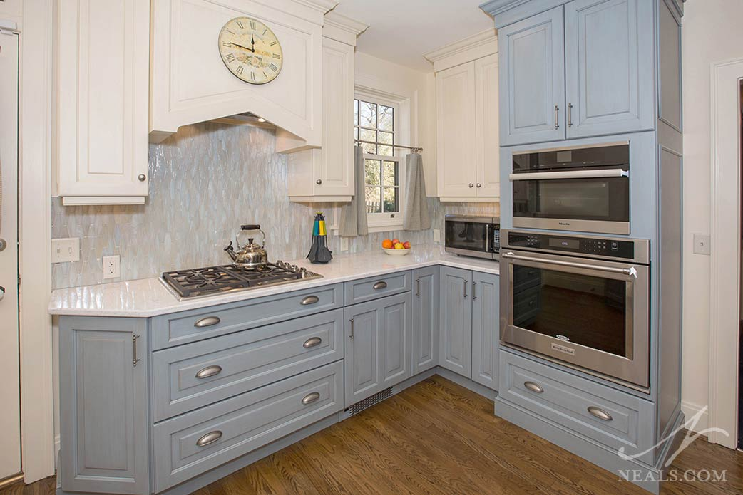 pale blue kitchen cabinets with vintage finish
