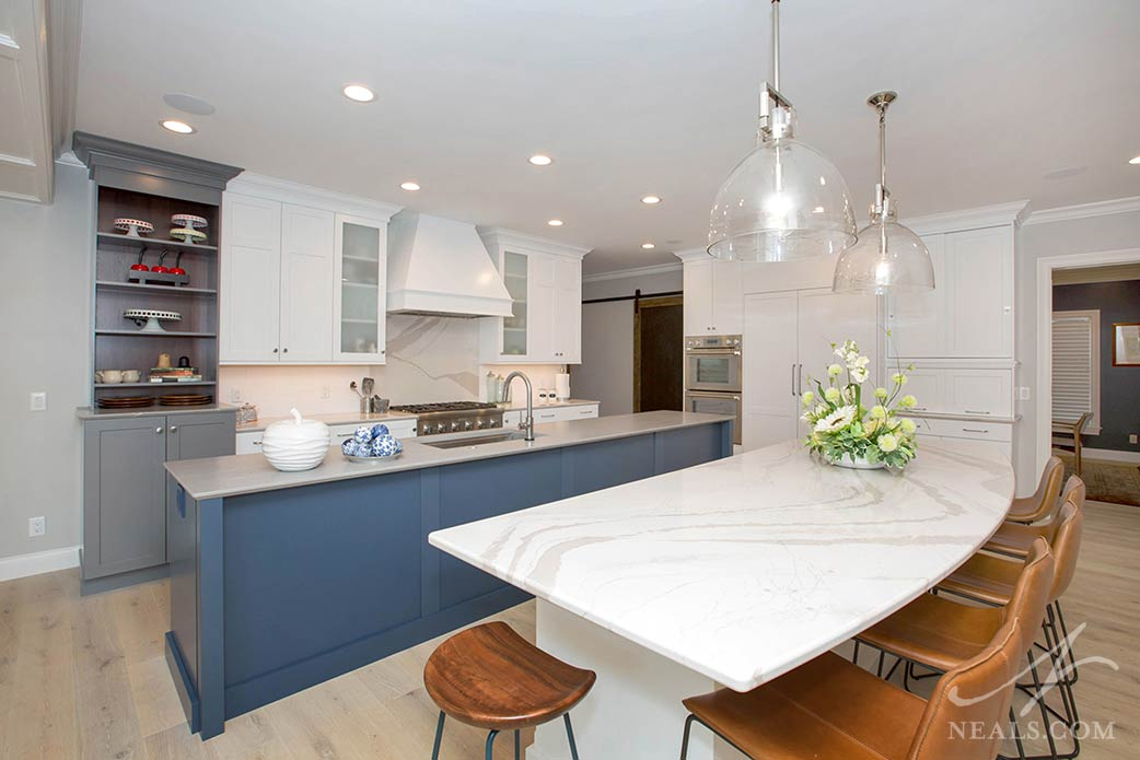 kitchen with gray and blue cabinetry