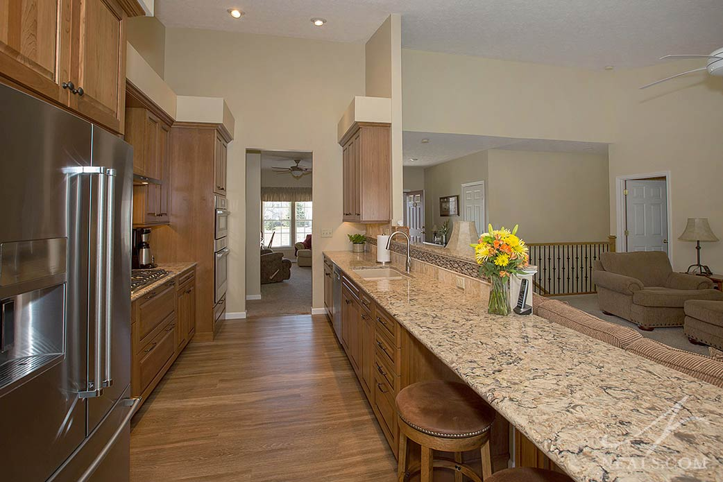 The statement-making peninsula counter of this Lebanon kitchen is Cambria Bradshaw quartz.