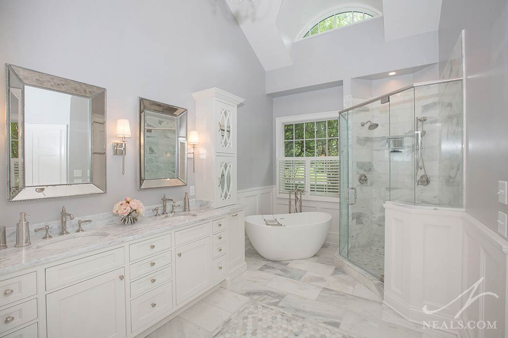 Marble features prominently in this Indian Hill master bathroom, including the First Snow marble vanity counter.