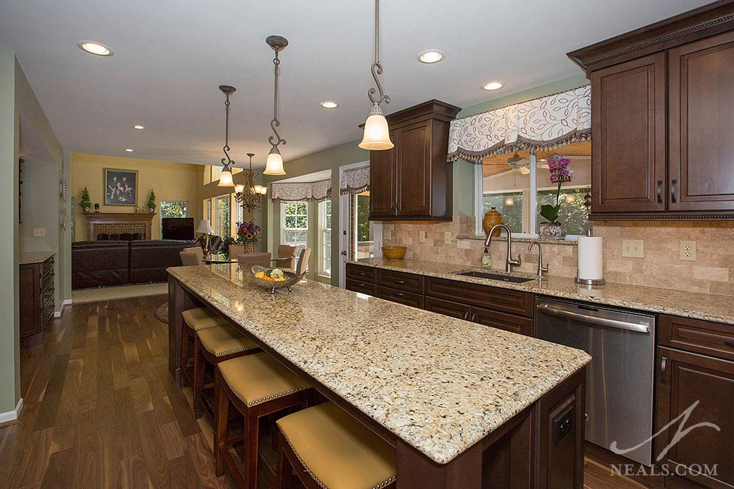 This Loveland kitchen features New Venetian Gold granite counters that brings the kitchen's entire color palette together.