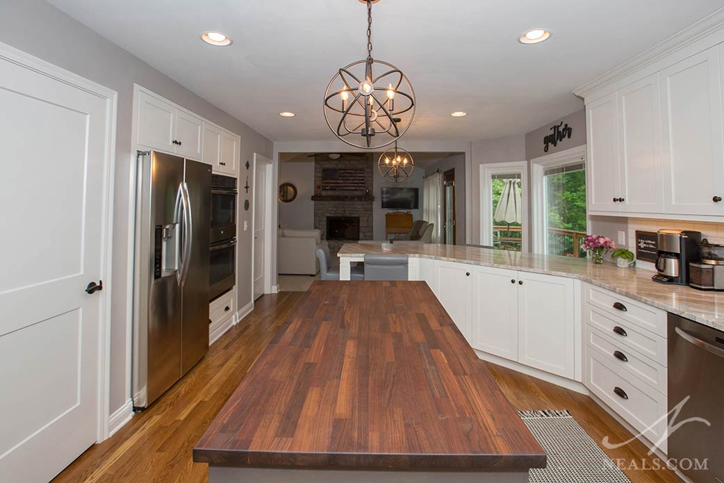 In line with over a century of tradition, the island in this West Chester kitchen is a sophisticated black walnut butcher block.