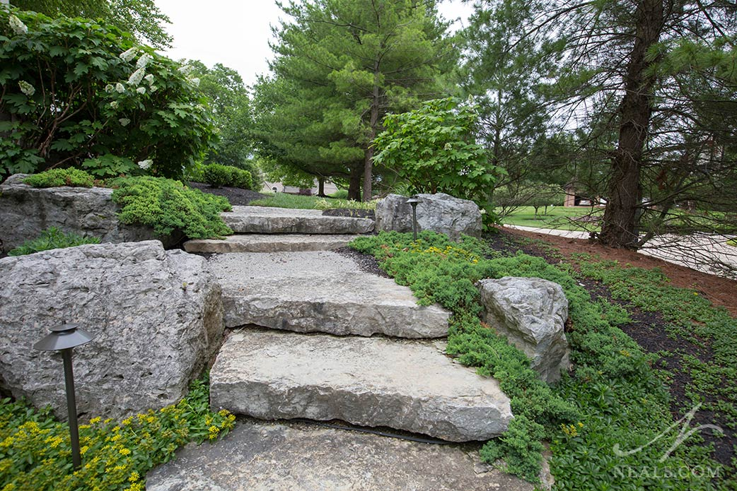 Boulders added to the landscaping in a Western Hills outdoor project.