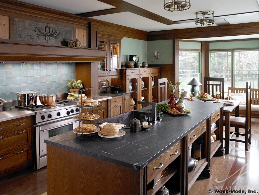 Craftsman style is known for warm, earthy colors, well-crafted woodwork, and artistic details, as seen in this kitchen by Wood-Mode Cabinetry.