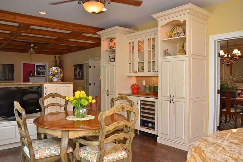 This new French country kitchen features a combined pantry and hutch, as well as a rich wood floor that will age well.