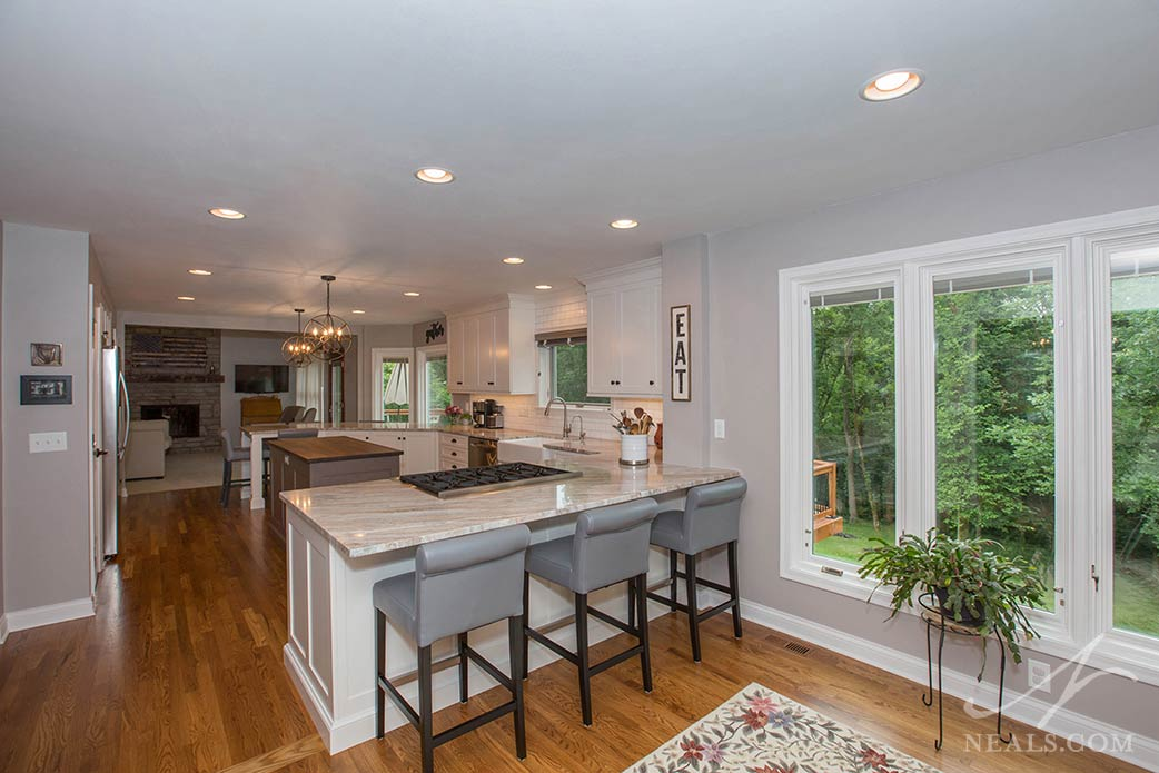 This West Chester kitchen uses peninsulas on both ends of the kitchen with different configurations of seating.