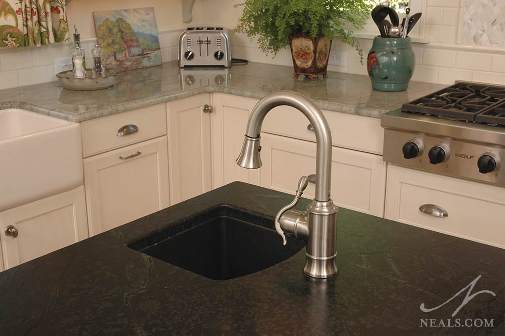 The island in this Glendale kitchen is outfitted with a small prep sink.